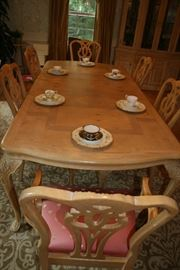 This is a 10 foot (two leaves) oak with birdseye maple inlay (Century) dining table with carved legs and an accompanying China cabinet.