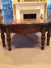 Designer wood coffee table with green marble trim accent
