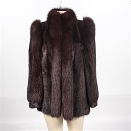 Mink and Brown Fox Fur Coat: A mink and brown fox fur. This fur coat features bracelet cuffs with a panel design, an open front and two outer pockets.