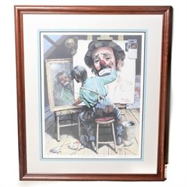 """Leighton Jones Signed """"Emmett's Self Portrait"""" Offset Lithograph: A signed offset lithograph of Emmett's Self Portrait by Leighton Jones. This piece depicts Emmett Kelly painting his sad looking self-portrait from a mirror. Wood frame with a canvas mat behind glass. Signed by the artist to the bottom and hanging wire to verso."""