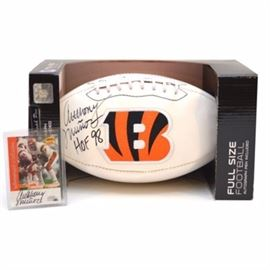"Anthony Munoz Autographed Football and Trading Card: An Anthony Munoz autographed NFL Bengals football and a Sports Illustrated Fleer autographed trading card. The football is signed by Football Hall of Fame player Anthony Munoz and includes ""HOF 98"" in black marker, in original packaging. The trading card is also signed in black marker and is part of the Sports Illustrated Autograph Collection. The reverse side of the card includes the Certificate of Authenticity issued by Fleer. Munoz played his entire professional career with the Cincinnati Bengals and is the only Bengal inducted in to the NFL Hall of Fame."