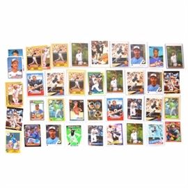 Forty-Four Rookie Baseball and Football Cards: A collection of more than forty-four Rookie baseball cards by Topps and Upper Deck. Highlights include five Derek Jeter cards, Bo Jackson, Barry Larkin, Barry Bonds, Drew Brees, Randy Johnson, Brett Favre, Mike Piazza, Manny Ramirez, Roger Clemens, Mark McGwire, Troy Aikman, Greg Maddux and more.