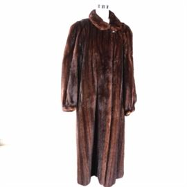 Nordstrom Mink Coat: A Nordstrom mink coat. This selection showcases a brown mink fur with a Peter Pan style collar and a brown lining. It is labeled by the manufacturer to the interior.