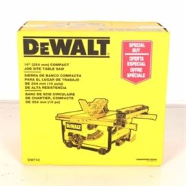 "10"" Compact Job Site Table Saw by DeWALT: A 10"" compact job site table saw by DeWALT. This table saw is still packaged in the original package featuring specifications and basic instructions. This piece is marked ""DeWalt"" to the box."