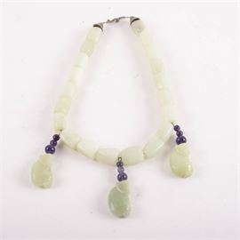 Carved Bowenite and Amethyst Necklace: A carved bowenite and amethyst necklace. The necklace features bowenite stones with nine amethyst round stones accenting three carved bowenite monkey pendants. The clasp is hallmarked or has been tested as sterling silver. The total weight, inclusive of all materials, is 4.565 ozt.