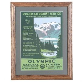 Framed Offset Lithograph Reproduction Olympic National Park WPA Poster: A framed offset lithograph Olympic National Park WPA poster. This reproduction print of an original Federal Art Project poster from the late 1930's depicts a colorful high contrast landscape showcasing the geographical features of the national park. It is presented under glass with a white mat and a stained wood frame. A hanging wire is included mounted to the verso.