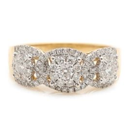 14K Yellow Gold 1.26 CTW Diamond Ring: This ring features a total of eighty one diamonds, weighing a total of 1.26 ctw, with three larger center diamonds each containing a halo of diamonds, prong set a top a crown of open work interlocking ovals encrusted in diamonds on a 14K yellow gold shank.