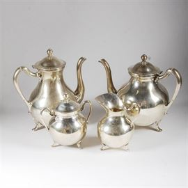"Sterling Silver Tea and Coffee Set from Mexico: A sterling silver coffee and tea service from Mexico. The service includes a lidded coffee pot, a lidded teapot, a lidded sugar bowl with two handles and a creamer pitcher. The pieces in the set are all marked ""Sterling 925 Hecho En Mexico"", along with a hallmark with the number ""37"" inside a mark, and a triangular mark. Total approximate weight, 98.010 ozt including precious and non-precious materials."