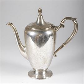 "Fisher Sterling Silver Teapot: A Fisher sterling silver teapot. The vintage teapot has clean lines, with a tall, rounded body that has a hinged lid with finial, a bead detail on a graceful spout, and white ring accents on the handle. The underside is marked ""FISHER"", with the number ""9432"" and a hallmark depicting a shield, crown and cursive letter ""f"", along with other faint marks. Total approximate weight, inclusive of non-metal materials, 11.370 ozt."