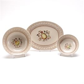 """Johnson Brothers """"Fruit Sampler"""" Serveware: A selection of Johnson Brothers Fruit Sampler serveware. This selection includes three pieces of serveware with a floral and fruit design. Each piece is marked """"Staffordshire Old Granite Made In England by Johnson Brothers Fruit Sampler"""" to the underside."""