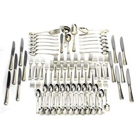 """Monogrammed Gorham Sterling Silver Flatware Set: A set of monogrammed Gorham sterling silver flatware. The set is engraved with the monogram """"VSA"""", and includes twelve each, iced tea spoons, salad forks, dinner forks and dinner knives. Also included are twenty-four teaspoons, one large spoon, one ladle, one soup spoon, one slotted spoon, one serving spoon and one small knife. The handles of all are marked """"Gorham Sterling"""", and the blades of the knives are marked """"Stainless Blade – Gorham Sterling Handle"""". The set comes in a wooden flatware storage box with brown felt lining marked """"Reed & Barton Tarnish Preventive Cloth"""". The lid of the box has a monogrammed oval with """"VSA"""" on it. Total approximate weight of the flatware, excluding the knives with the stainless blades, 82.940 ozt."""