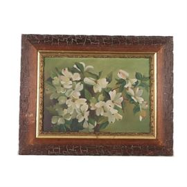 """Fannie Gorham Oil Painting of White Dogwood Flowers: An oil painting on canvas of white dogwood flowers attributed to Fannie V. Gorham. This painting depicts a plant adorned in white blooming flowers in front of a green background. The painting is mounted in a stained wood frame with a gold tone decorative liner. A wire for hanging purposes and a hand written note reading """"Fannie V. Gorhan when student at Cardome Acad."""" are present to the verso of the frame. The Cardome Academy was a Catholic Girl's School in Georgetown, KY."""