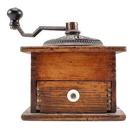 """Arcade Imperial Antique Coffee Grinder: A Arcade Imperial antique coffee grinder. The grinder has a cast iron top marked """"Arcade Imperial MFG.Co"""" with a metal grinder on a wooden base. The front has a pull out drawer with a ceramic knob."""