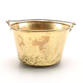 Brass Bucket With Bail Handle: A brass bucket. This bucket feature slightly tapered shape with an applied metal bail handle. It is unmarked.