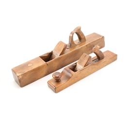 Wooden Planers: A pair of wooden planers. The pieces are composed of wood with a smooth finish. They are not marked.