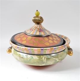 "MacKenzie-Childs ""Torquay Frank"" Hand Painted Tureen: A hand-painted ceramic Torquay Frank tureen from MacKenzie-Childs. The basin is painted with a variety of colors, including a red clay-like matte paint, gold-tone foil paint, and an olive green paint in a marbled pattern. The piece has two handles painted with metallic tones and a metal and stone topper."