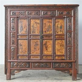 Antique Wooden Wardrobe/Entertainment Center: An antique wardrobe refurbished into an entertainment center. The piece is intricately hand carved with a serrated pattern in the edge and floral panel inserts around the doorway and three drawers. The piece has had the doors removed and holes placed in the back for cords.