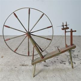 Antique Painted Spinning Wheel: An antique spinning wheel, painted green with red accents. There is still thread on the spindle. This is a 'great wheel', one of the oldest types of spinning wheels. Follow link for more details.