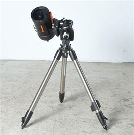 Celestron Telescope and Accessories: A Celestron telescope and various accessories. The device includes the dec port, the tripod base, a rechargeable double power station with spot light, and more. All pieces aside from the tripod come with carrying cases.