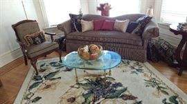 Sofa, Chair, Glass Top Coffee Table, Floral Rug