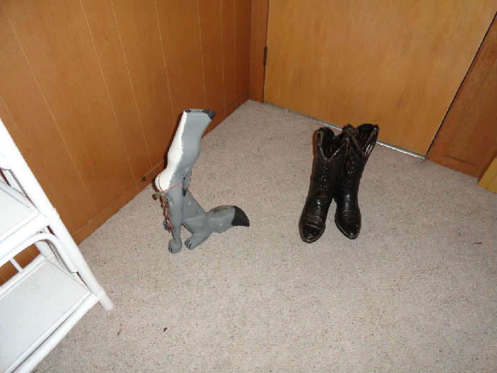 Unique Southwestern items.  A howling wooden coyote and a pair of heavy plaster cowboy boots.