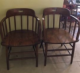 Two of seven barrel back chairs