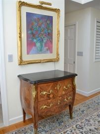 Marble top bombe chest and artwork by Kahlil Gibran