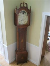 Inlaid mahogany case tall clock of Central NY origin made circa 1810.  Painted dial attributed to the Boston firm of Nolan & Curtis.  Brass time & strike movement, 8' tall