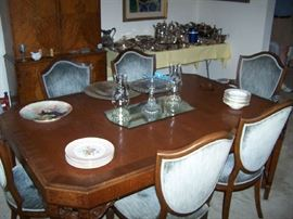 DINING TABLE ( HAS 5 LEAVES) AND SHIELD-BACK CHAIRS