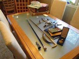 Antique canes, boy scout stuff and treasures