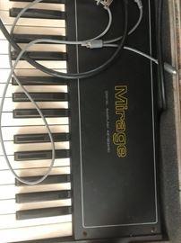 #49 Ensonic Mirage keyboard in case w/ stand $200