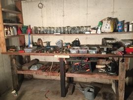 Tools and tools; Craftsman plumber's wrenches, clamps, table saw, router with many parts, heavy vise, dremel jig saw.