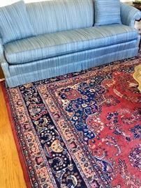 "Lovely blue upholstered sofa and a 14'3"" by 10' rug"