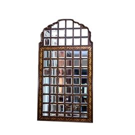 Contemporary Grid Wall Mirror: A contemporary grid wall mirror. This wall mirror features a wood frame with an arched scalloped top and gold gilt leaf design. The individual beveled glass mirror panes are presented in a wood grid frame with gold tone nailheads to each intersecting corner.