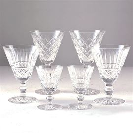 Waterford Lismore Glasses: A selection of Waterford Lismore glasses. This selection of stemware features two tall wine glasses with diamond motif, a medium pair of goblets with flared motif and a smaller pair of sherry glasses with flared pattern. All glasses have ball stems and round base. Pieces are marked to the bases.