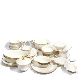 "Lenox Dish Assortment: A Lenox dish assortment. Included in this assortment are twelve cereal bowls, a lidded candy dish, two oval serving dishes ""Eternal"" pattern, oval serving platter, footed chip and dip, pair of candlesticks. dove dish, Monticello double leaf candy dish, a creamer, butter dish, and a small chip and dip."