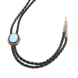 Sterling Silver Turquoise Braided Leather Bolo Tie: A braided black leather bolo tie with sterling silver and a turquoise stone.