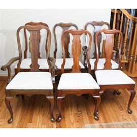 Six Queen Anne Style Cherry Dining Chairs by Pennsylvania House: A set of six Queen Anne style dining chairs by Pennsylvania House. Each of these chairs is constructed from cherry and features a fiddle back with a scroll-cut splat over a seat upholstered with textured beige fabric. All six sit on cabriole front legs with square-cut rear legs, and two have armrests.