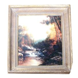 James Freeman Original Landscape Oil Painting: An original oil on canvas landscape painting by James Freeman. The painting features a depiction of a river flanked by trees with fall foliage and hazy mountains and blue sky to the background. The painting is signed to the lower right and presented in a modern gilt frame.