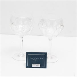 "Waterford Crystal Millenium Water Goblets ""Health"": A pair of Waterford Crystal Millenium water goblets featuring the design for Health. These glasses feature cut sunburst patterns to the rounded cups, faceted stems, and round bases. Maker's mark to the underside."