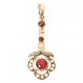 Victorian 10K Yellow Gold, Garnet, and Seed Pearl Drop Pendant: A Victorian 10K yellow gold flower drop pendant featuring three round cut garnets framed by seed pearl side stones and milgrain edges.