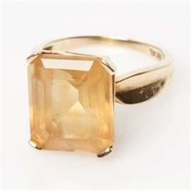 10K Yellow Gold and 9.60 CTS Citrine Cocktail Ring: A 10K yellow gold and cut-cornered emerald cut citrine cocktail ring.