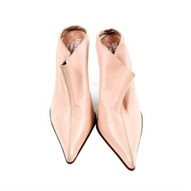Dibrera Pink Women's Heels: A pair of heels by Dibrera Pink. These Italian made leather shoes feature a slip-on design with beige uppers and a pointed toe-box.The Dibrera trademark is presented to the bottom soles and insole lining. These shoes are a size 36.5.
