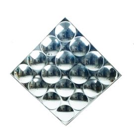 Mid Century Modern Mirrored Wall Hanging: A retro style mirrored wall hanging. This unique wall mirror features twenty-eight raised circular mirrored discs in a square formation. There are no labels or markings present. Wired for hanging on the verso.
