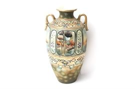 Art Nouveau Period Chinese Vase: An Art Nouveau period Chinese double handled vase. This finely detailed work features a hand painted center design of a cottage with lotus blossoms, matte glaze accents and, moriage style raised gilt beading. This unsigned work has been rendered in soothing palette of lavender, cream, peach, green, and ivory.