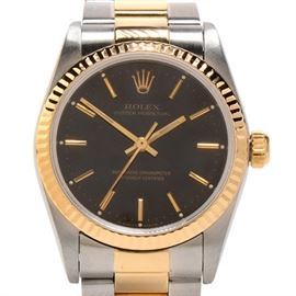 Rolex Oyster Perpetual Mid-Size 18K Gold & Steel Black Automatic: A unisex Rolex Oyster Perpetual mid-size 18K yellow gold & stainless steel black automatic wristwatch. It comes with Original Rolex boxes and papers (Dated Dec 2003).