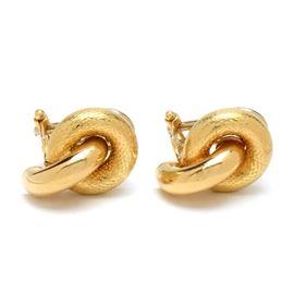 Italian 18K Yellow Gold Omega Back Pierced Knot Earrings: A pair of Italian 18K yellow gold omega back pierced knot earrings in a textured and high polish finish.