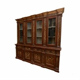 French Provincial Style China Cabinet: A French Provincial style china cabinet. This cabinet features a molded edge top over a set of four cabinet doors with mesh panels each flanked by column stiles over a set of four drawers and four small cabinet doors with raised panels. The piece rises on a platform base and features painted detail throughout.