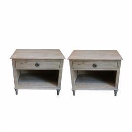 """Pair of Nightstands by Restoration Hardware: A pair of nightstands by Restoration Hardware. These nightstands feature a rectangular top that overhangs above a drawer with ring pull over an open shelf. The tables rise on fluted tapered legs and are marked to the drawer """"Restoration Hardware."""""""