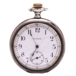 "Antique Circa 1902 Waltham Sterling Silver Pocket Watch: An antique, circa 1902, Waltham sterling silver pocket watch. This piece features a sterling silver case, which is monogrammed, ""FCG"" on verso. The case houses a white dial with black Arabic hour indexes, red minutes indexes to the outer dial, thin, cobalt blue spade hands, and a sunken seconds sub-dial at six o'clock."